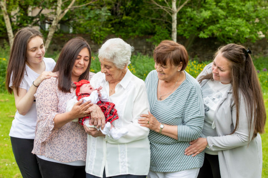 L-R Toni-Leigh, 17, Chyrel, 50, Mary Marshall, 86 with Two-week-old Nialia, Rose, 68 and Carrie, 35. Six generation family (thought to be biggest in Scotland) oldest is 86 and youngest is a week old. June 9 2021 . See SWNS story SWTPgeneration. A family have become one of the only in the UK with six generations alive at the same time - with one becoming Scotland's only great-great-great-grandma aged 86. The family, stretches from oldest member Mary Marshall, 86, to their youngest member Nyla Ferguson, who is just a couple of weeks old. Mother-of-eight Mary - who was born four years before the start of World War Two - boasts a whopping 90 grandchildren. The women are all on the same side of the family - and all except new mum Toni-Leigh work, or worked, as carers for the NHS.