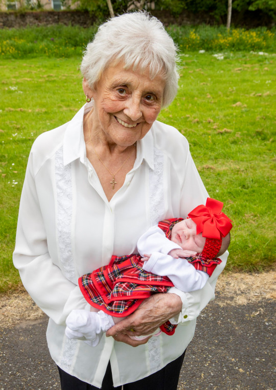 Mary Marshall with her great great great granddaughter Nialia. Mary Marshall, 86, Rose, 68, Chyrel, 50, Carrie, 35, Toni-Leigh, 17, Nialia, b. 25th May 2021. Six generation family (thought to be biggest in Scotland) oldest is 86 and youngest is a week old. June 9 2021 . See SWNS story SWTPgeneration. A family have become one of the only in the UK with six generations alive at the same time - with one becoming Scotland's only great-great-great-grandma aged 86. The family, stretches from oldest member Mary Marshall, 86, to their youngest member Nyla Ferguson, who is just a couple of weeks old. Mother-of-eight Mary - who was born four years before the start of World War Two - boasts a whopping 90 grandchildren. The women are all on the same side of the family - and all except new mum Toni-Leigh work, or worked, as carers for the NHS.