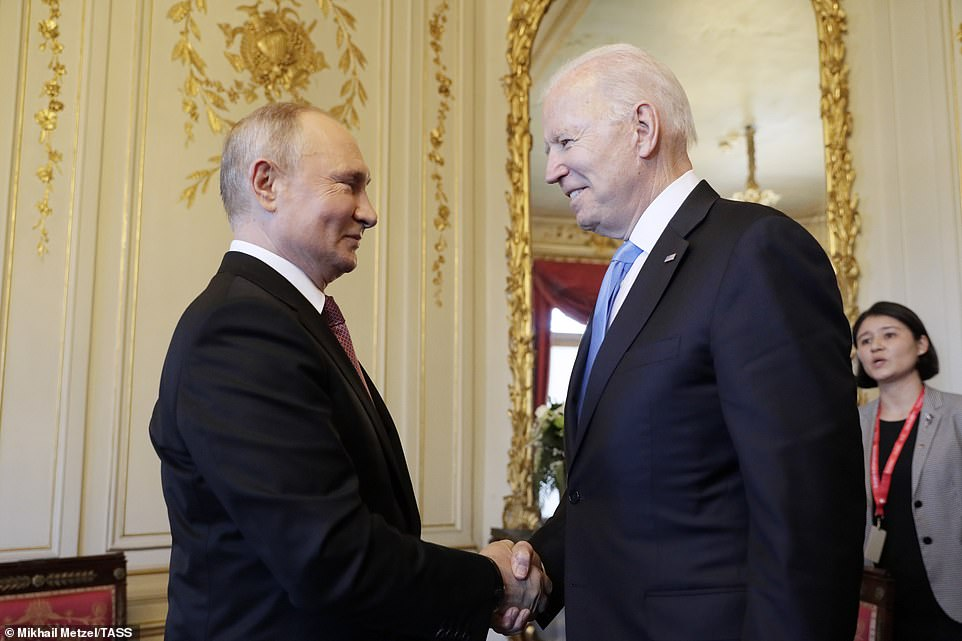 Putin shakes hands with Biden inside the opulent Villa de la Grange overlooking Lake Geneva after posing for a photo with the Swiss President Guy Paremlin outside