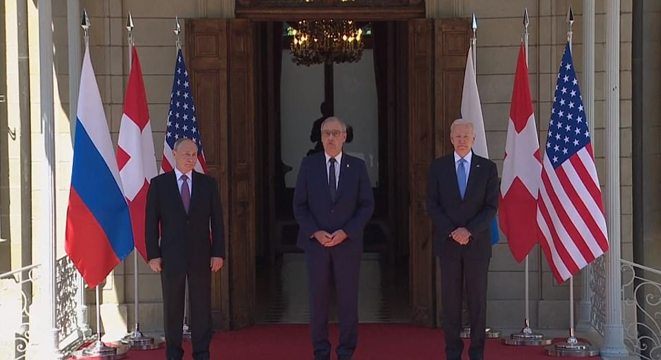 The two men arrived at the summit within a few minutes of each other: Putin, after a last-minute arrival by air and motorcade; Biden by driving from his nearby hotel, having arrived Tuesday (pictured: the pair posing with Swiss President Guy Parmelin at the highly-choreographed meeting)