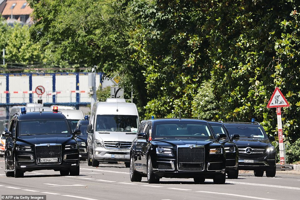 Putin's motorcade rolls through Geneva on Wednesday.Street lights for Putin's route on the brief drive to the villa were flashing yellow, with a main thoroughfare along the lake completely cleared of traffic for the summit.