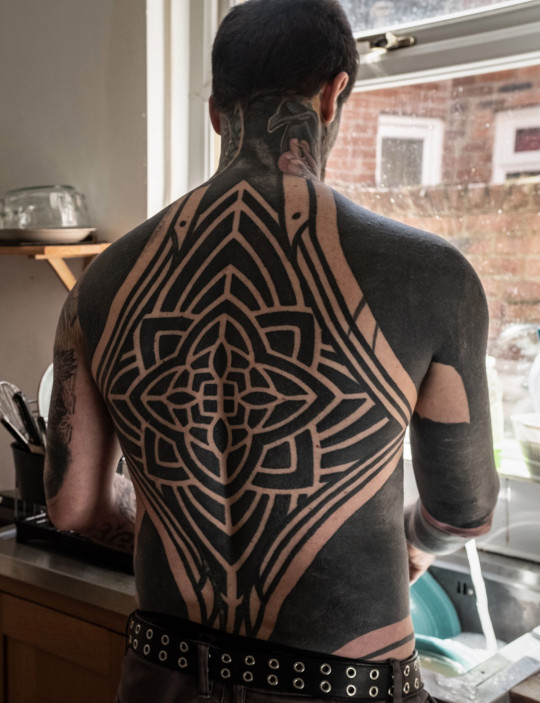 The tattoo enthusiast has the whole of his back tattooed