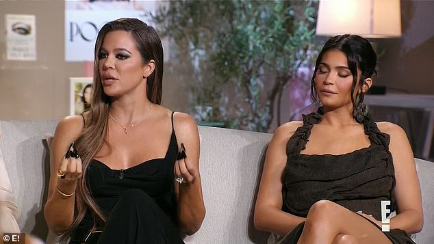 Close bond: Khloe and Kylie who share a close bond sat next to each other