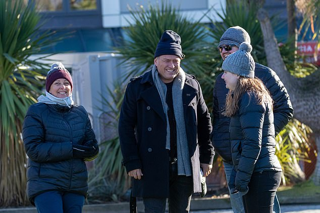 Group debrief: The hosting duo then went their separate ways - Karl chatted with members of the Today team.He kept warm from the New Zealand chill in a big and cosy black coat, with a beanie