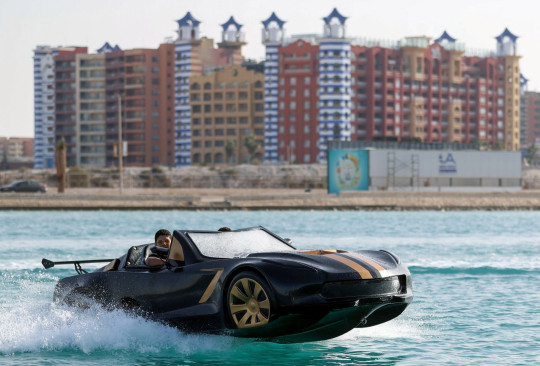 A man drives a vehicle, designed and invented by three Egyptians, that can drive on water at Porto Marina in Alexandria, Egypt June 11, 2021. Picture taken June 11, 2021. REUTERS/Mohamed Abd El Ghany