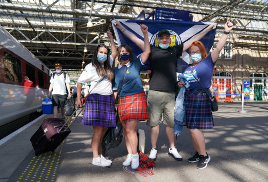 Scotland fans at Edinburgh Waverley railway station as they prepare to travel to London ahead of the UEFA Euro 2020 match between England and Scotland at Wembley Stadium. Issue date: Friday June 18, 2021. PA Photo. SOCCER England. Photo credit should read Jane Barlow/PA Wire.