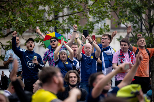 Scotland football fans singing and clapping outside King's Cross Station on June 17, 2021 in London, England.
