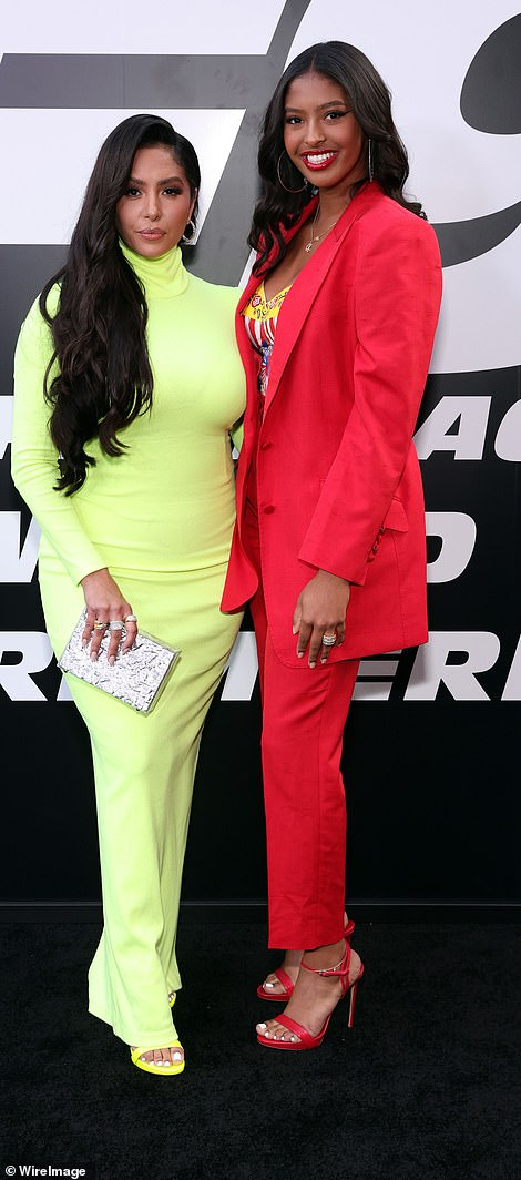 Duo: Vanessa and Natalia posed for photos as they opposed in each other in green and red