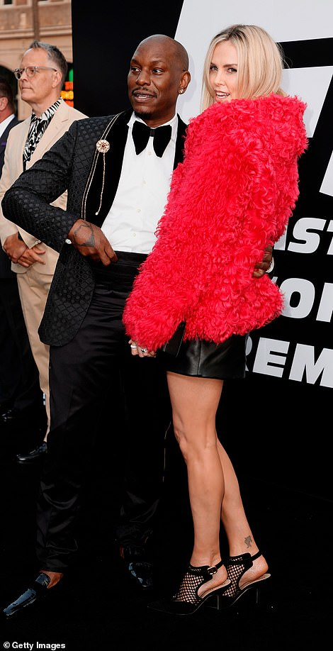 Suave: Tyrese Gibson got all gussied up for his film's big night; Tyrese pictured with costar Charlize Theron