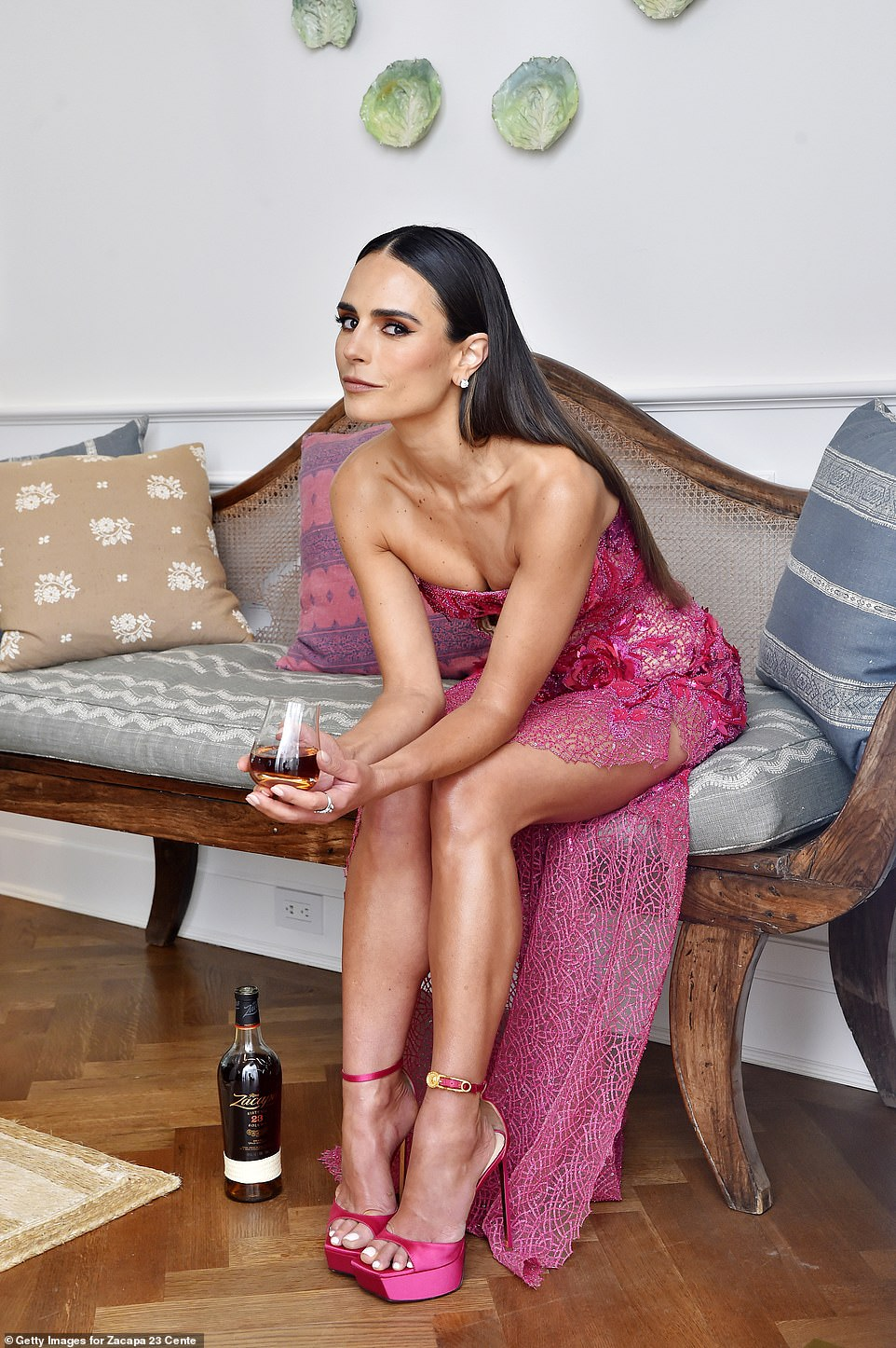 Shining bright: In intimate snaps of her getting ready she posed with rum