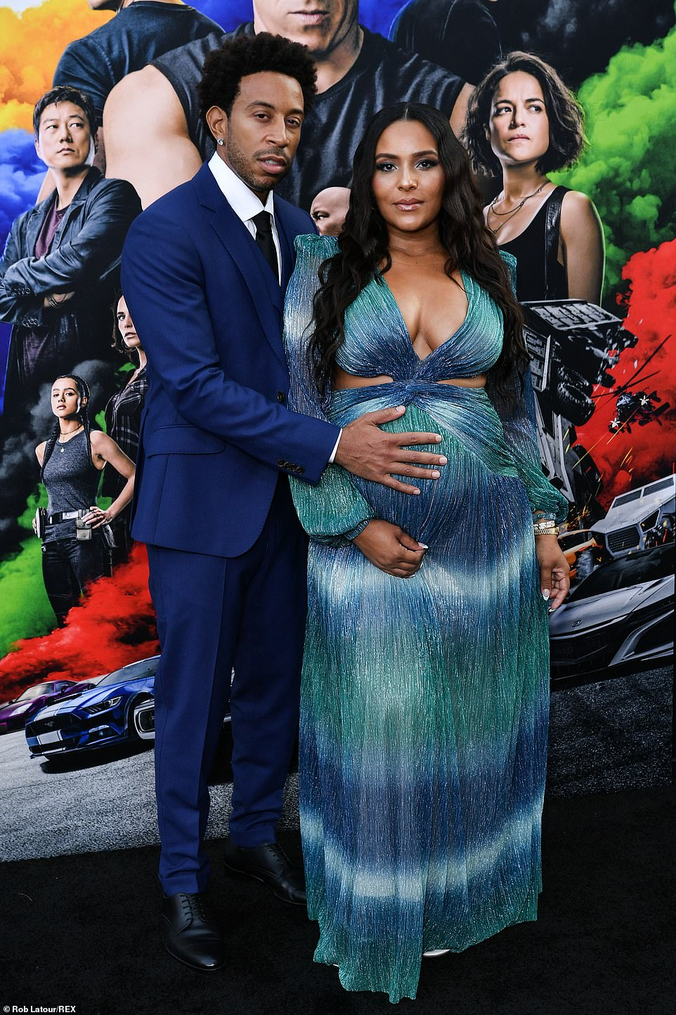Growing family: Ludacris rested his hand on his wife Eudoxie's pregnant belly
