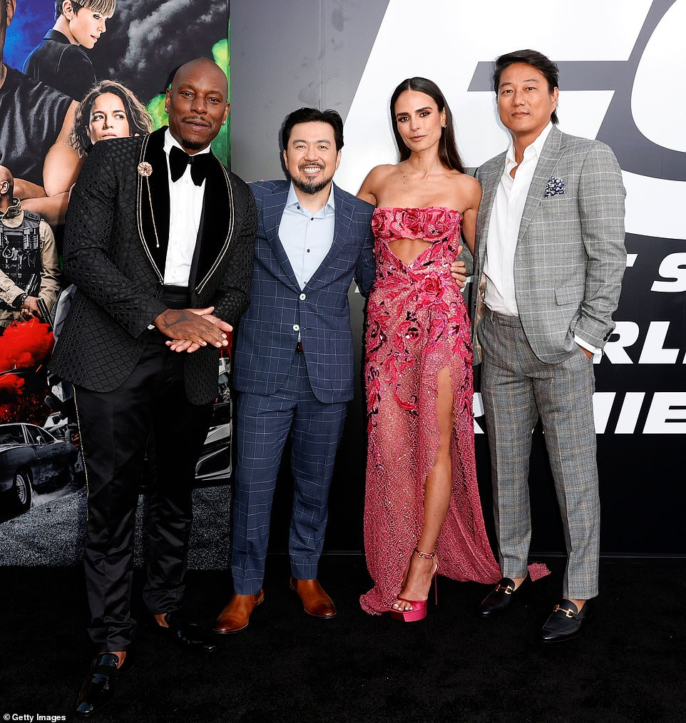Ensemble: Tyrese Gibson, Justin Lin, Jordana Brewster and Sung Kang gathered together for a group shot on the carpet