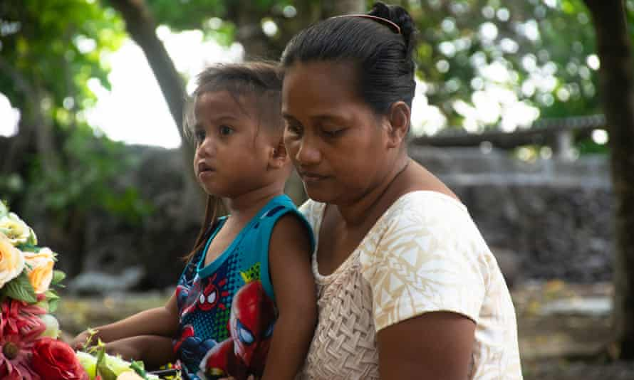 Tekarara, the wife of fisheries observer Eritara Aati Kaierua, with their youngest child Tutu. She has numerous concerns about the investigation into her husband's death