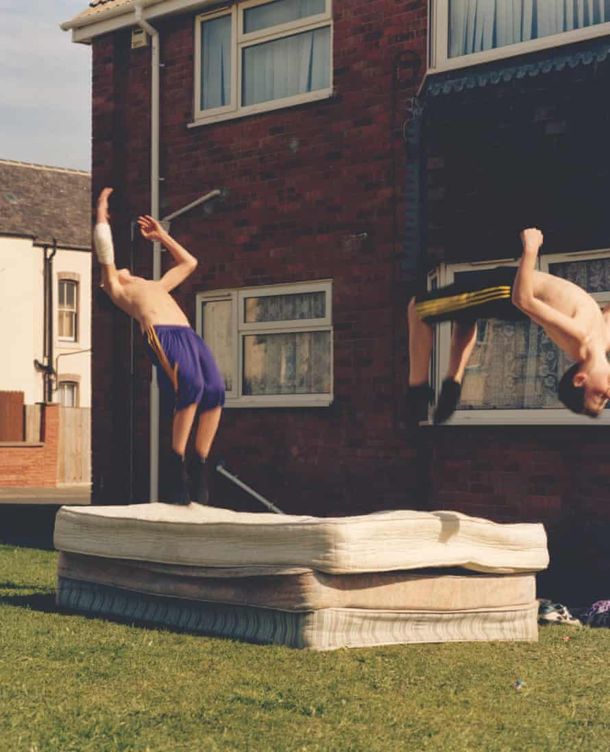 Image from The British Isles by Jamie Hawkesworth of two young men backflipping on some mattresses