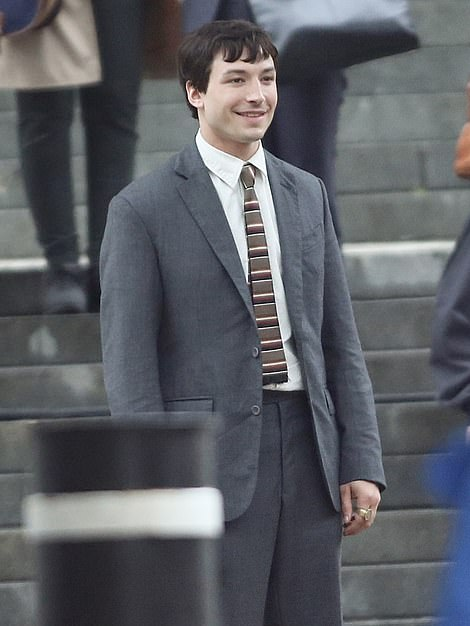 Suited and booted: Ezra was snapped wearing a suit and tie