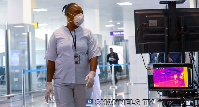 A woman wears a mask at a Nigerian airport amid the coronavirus outbreak in the country.