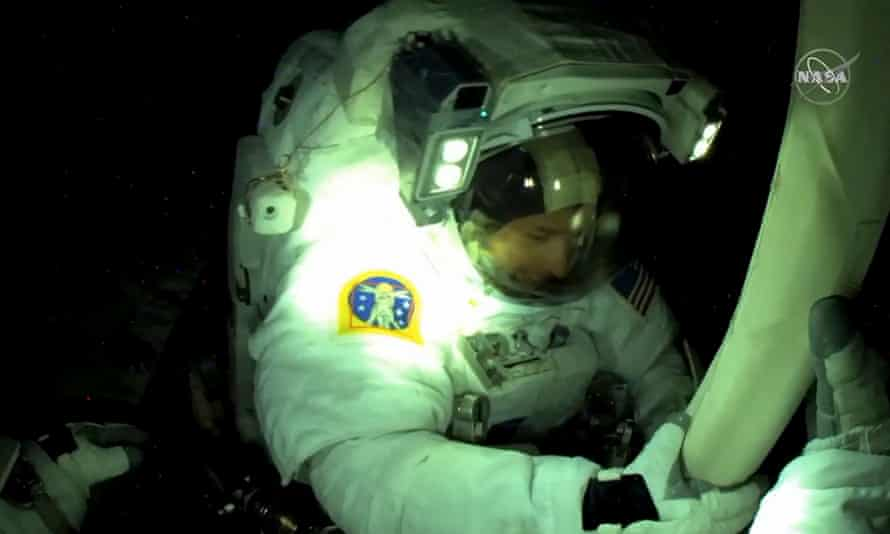 US astronaut Shane Kimbrough seen from European Space Agency astronaut Thomas Pesquet's helmet camera, fixing bolts, during unfolding and alignment of the solar panel.