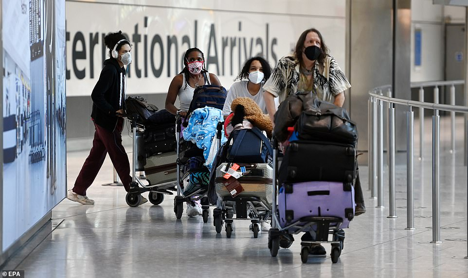 As well as easing the rules on travel quarantine for fully vaccinated Brits, ministers also want to ditch stay-at-home orders for those who come into contact with Covid cases (pictured, travellers wheeling their luggage through Heathrow)