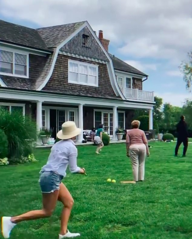 Lopez at play: In this image Jennifer is seen from the back as she plays a game with her kids, her mom and Alex