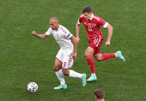 Denmark's Martin Braithwaite in action with Russia's Roman Zobnin.