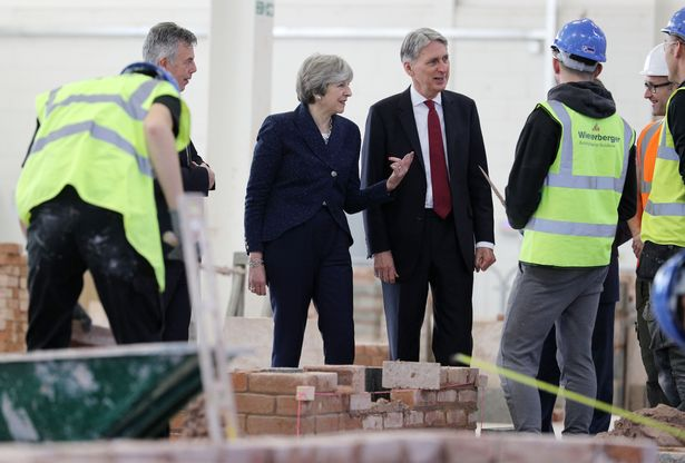 Ex-PM Theresa May is among the critics