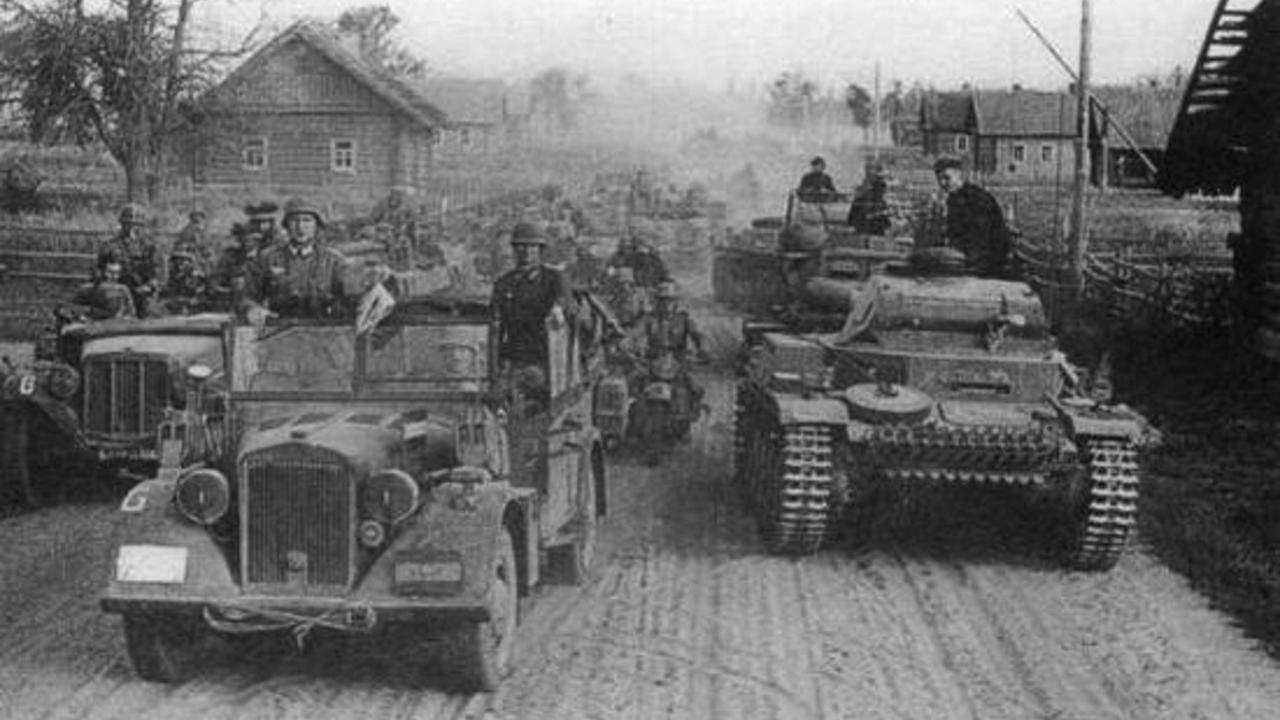 German soldiers drive down a road near Proujany, Belarus, June 1941.