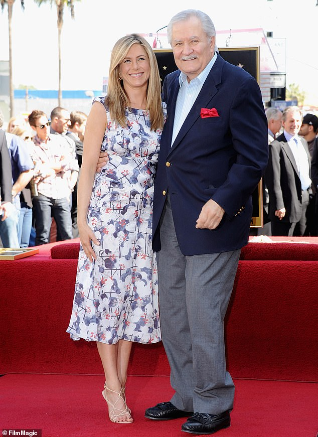 """Daddy:'Sometimes you can't help family members or people sending stuff over going, """"What is this? You're having a baby? Are you getting married?""""' said the actress who has never had children. Her family members include soap opera star father John Aniston (pictured in 2012) and half brother Alexander John Aniston. Her mother Nancy Dow passed away in 2016"""