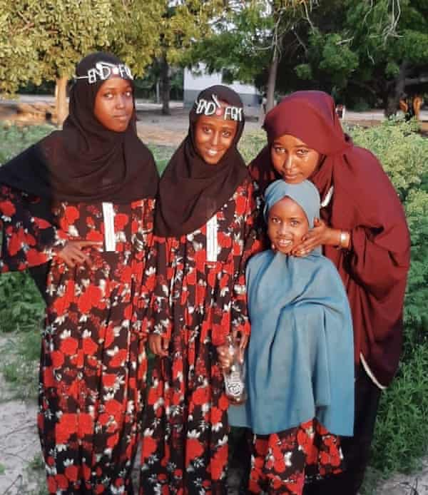 Hussein with her daughters.