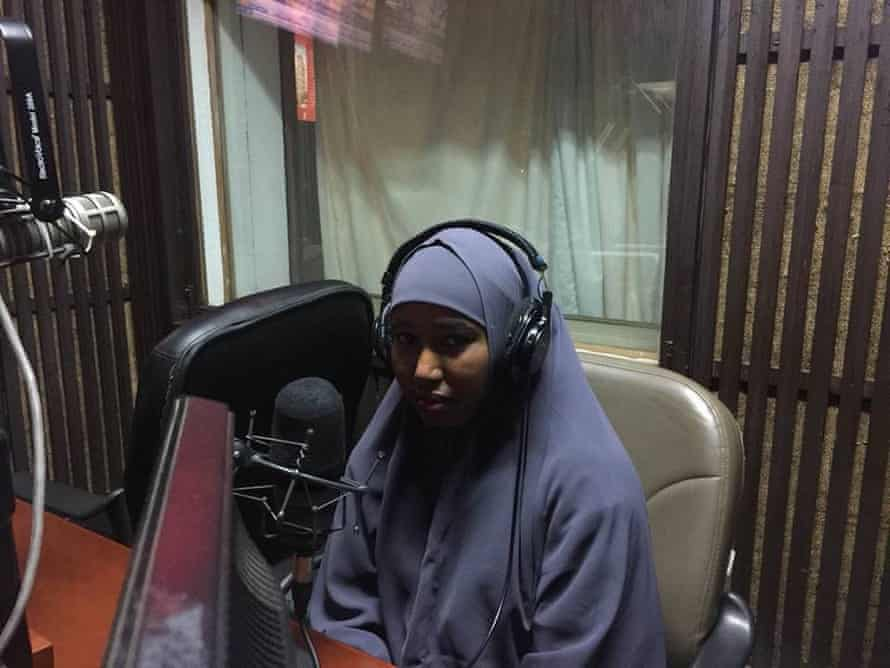 Hussein speaking on the radio in 2018.