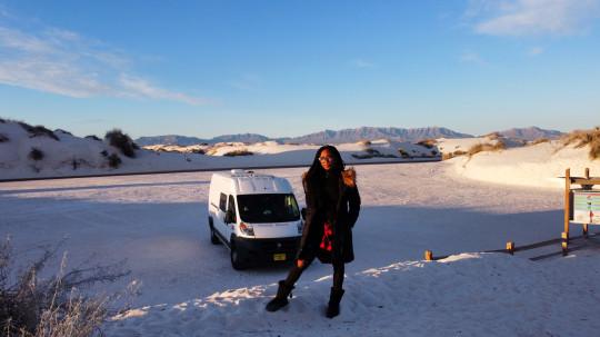 Jasmine Wilson standing in the snow with her van