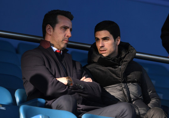 Edu and Mikel Arteta look on during Arsenal clash with Everton