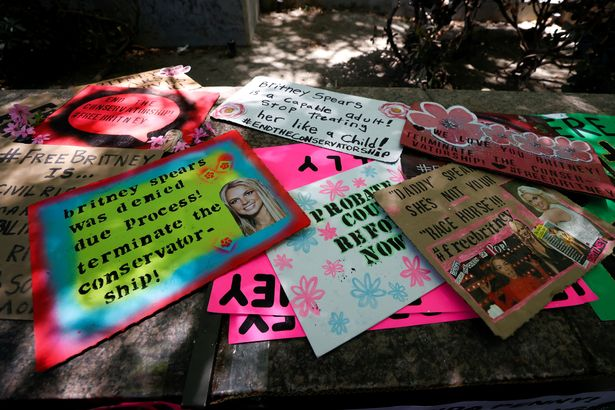 Placards are displayed during a protest in support of pop star Britney Spears