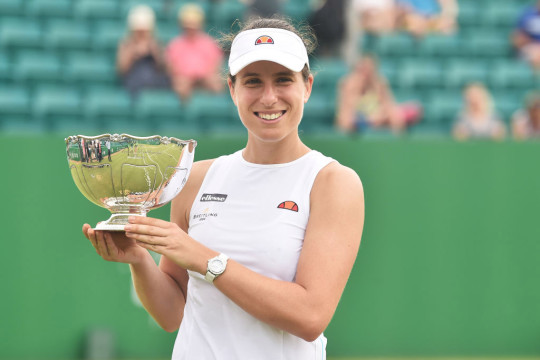 Johanna Konta of Great Britain holds the Viking Open Trophy after she beats Shuai Zhang of China at Nottingham Tennis Centre on June 13, 2021 in Nottingham, England.