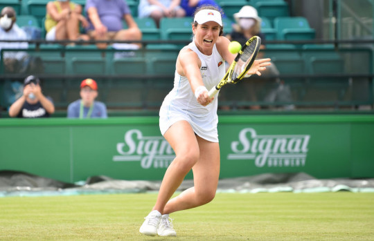 Johanna Konta of Great Britain plays a backhand shot against Kateryna Kozlova of Ukraine during the women's singles match on day six of the Viking Open at Nottingham Tennis Centre on June 10, 2021 in Nottingham, England.
