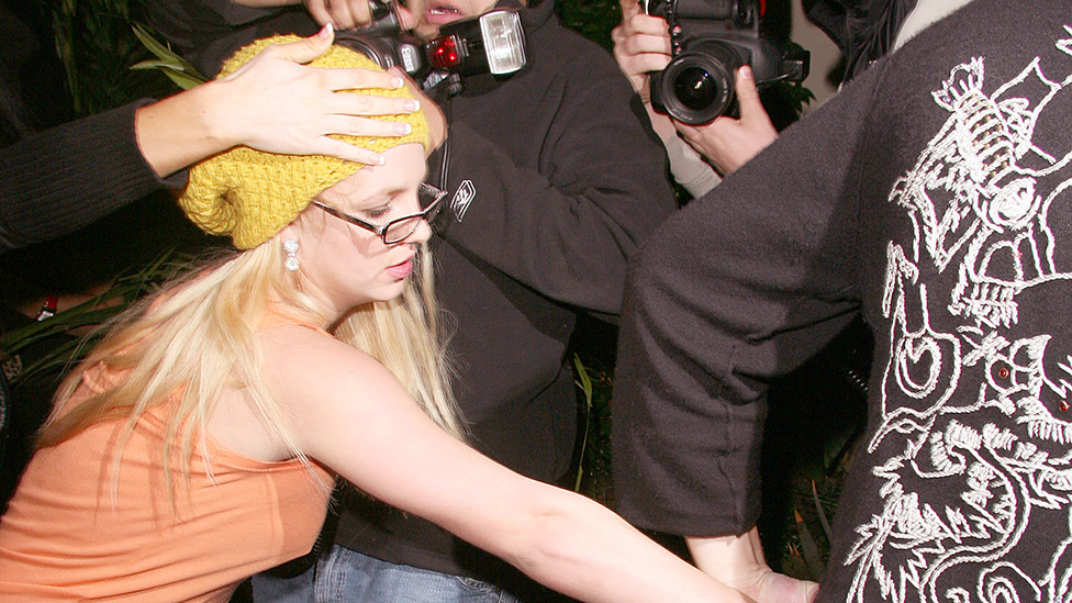 Spears was often pictured fleeing from tabloid photographers