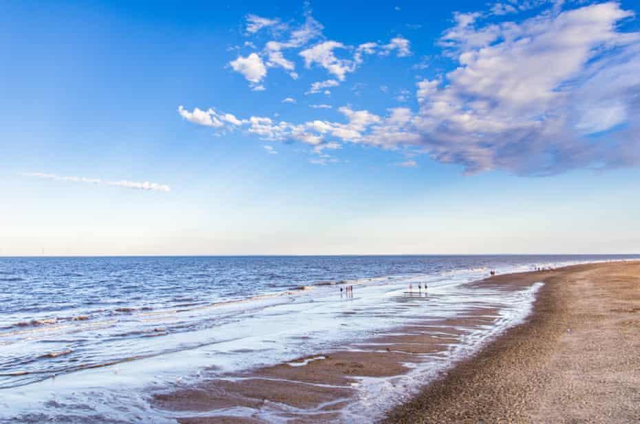 Beach, Skegness, UK, on a sunny, blue-sky day.