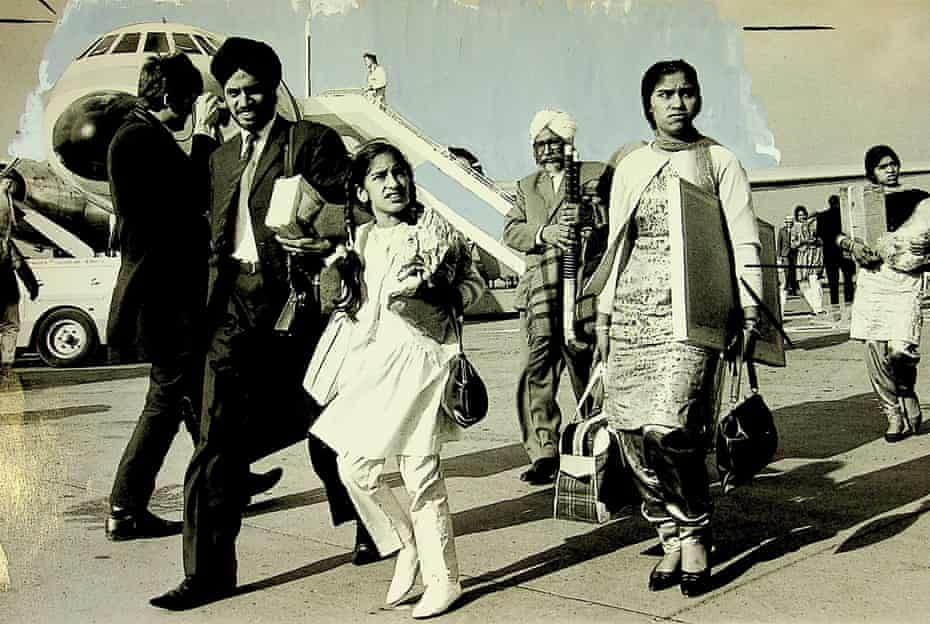 """Asians from Kenya arriving at Gatwick, 1968. Caption reads: """"Gatwick Airport, London, a morning scattered with frost, sun, fog and lamentations. The reception lounge is filling up with white turbans, neatly trimmed mustaches, faint beards, vey well-pressed suits fashionably devoid of turnups. More than 100 Asians from Kenya - Britsh citizens - are due to arrive and their relatives and friends already in England have turned out to meet them..."""""""