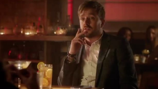 Iain's character sits alone in a bar in his new sitcom Buffering