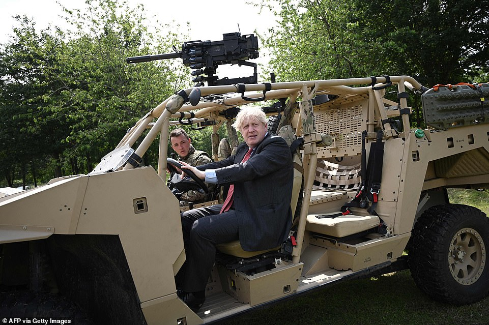 Boris Johnson (pictured on a visit to Aldershot barracks today) appears increasingly fixed on the July 19 unlocking after internal government assessments warned keeping even limited rules for longer would spell disaster for the hospitality sector and hundreds of thousands of jobs