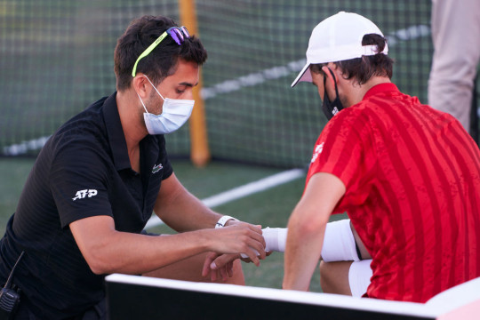 Dominic Thiem of Austria receives medical treatment during his Round of 16 match against Adrian Mannarino of France on day four of the Mallorca Championships 2021 at Country Club de Santa Ponça on June 22, 2021 in Calvia, Spain.