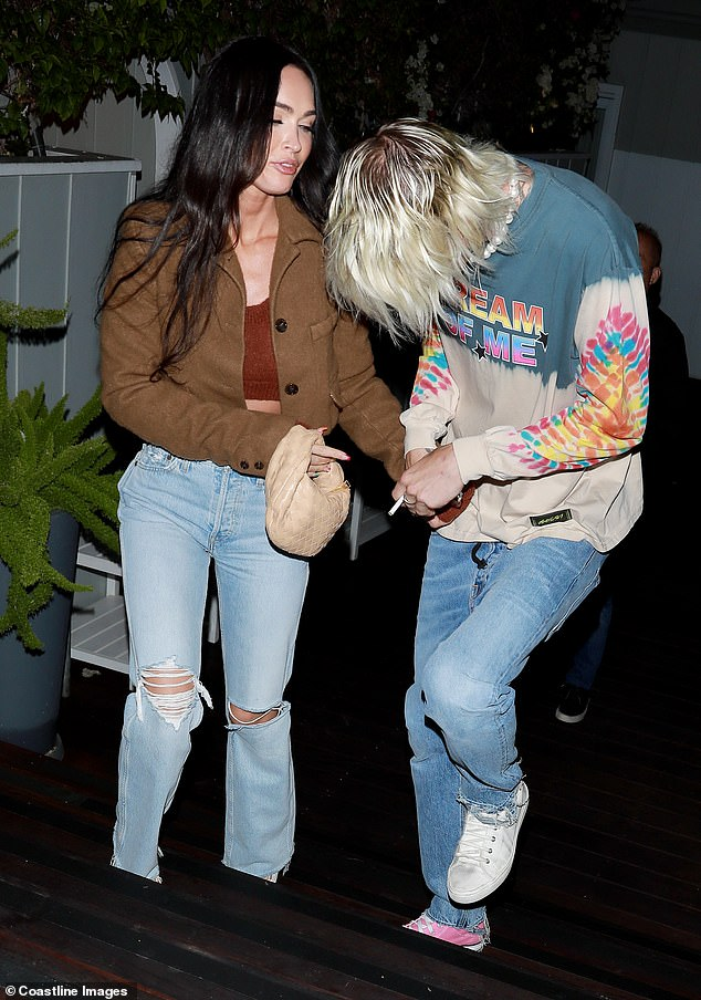 Casual chic:Megan complemented her ensemble by wearing a pair of light-wash denim jeans, and she boosted her height in black heels