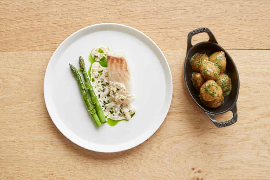 The Barn at Moor Hall's brown butter poached Cornish turbot roe with tartare asparagus and jersey potatoes.