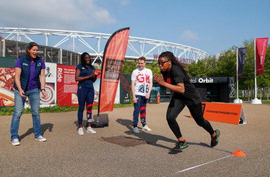 (L-R) Dame Katherine Grainger, Olympian Christine Ohuruogu and Paralympian Ollie Hyndm encourage Badu Sports athlete during the media launch of From Home 2 the Games at Queen Elizabeth Olympic Park on June 03, 2021 in London, England. From Home to the Games is a Talent ID programme for Olympic and Paralympic Athletes of the future. (Photo by Luke Walker/Getty Images for UK Sport)