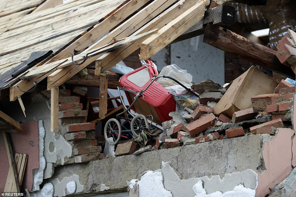 A stroller is seen among debris in a building in the aftermath of a rare tornado that struck and destroyed parts of some towns, in Mikulcice village, Czech Republic