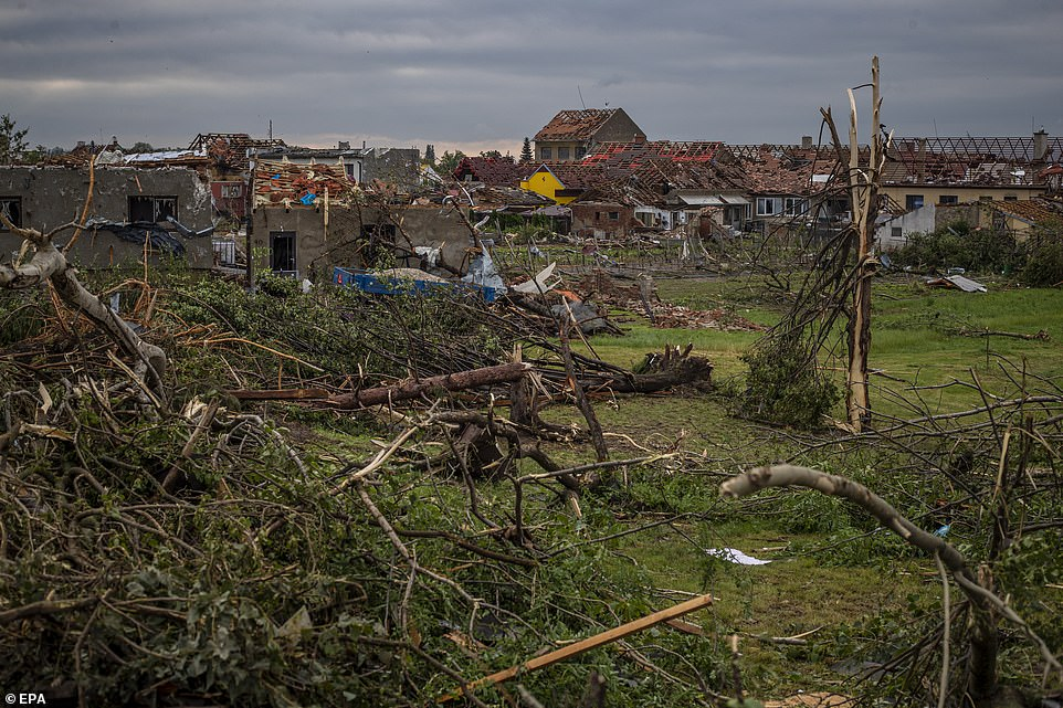 This picture shows the aftermath of the tornado in Mikulcice, Czech Republic. It swept through the region of South Moravia, in south-eastern Czech Republic, leaving thousands of houses destroyed and damaged