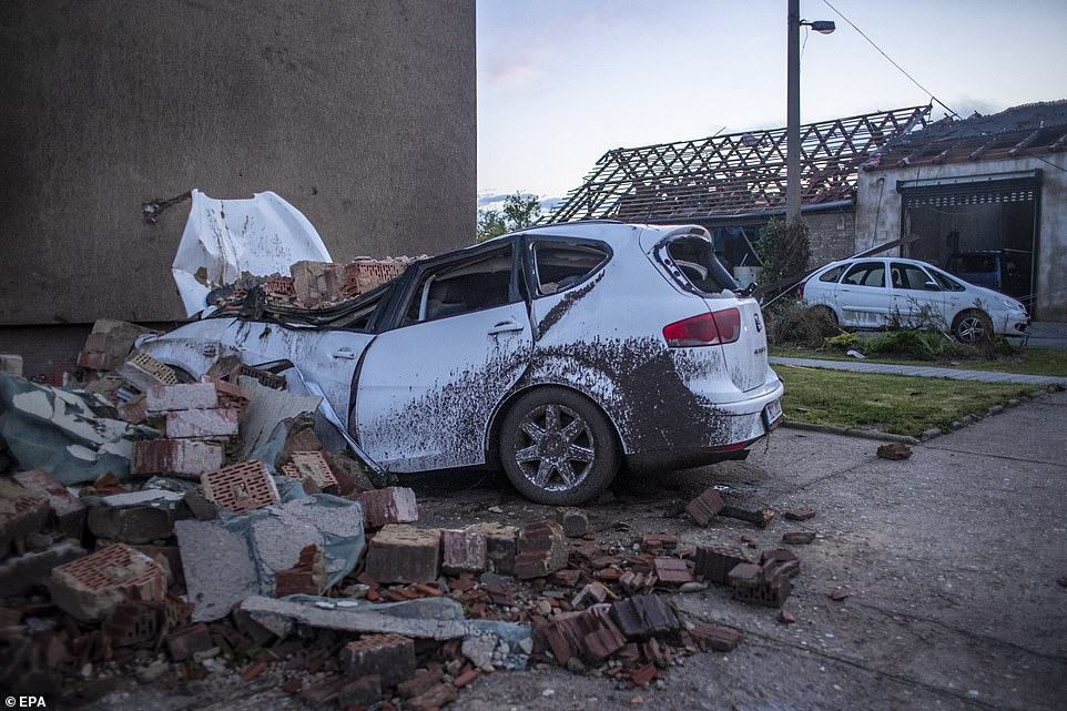 Cars were crushed by falling bricks as the rare tornado laid waste to entire villages in the Czech Republic. This was the scene in Moravska Nova Ves