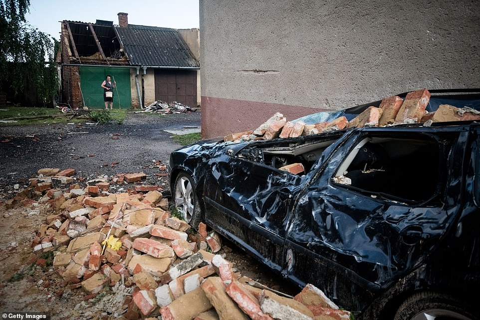A car has been damaged by a collapsed building inMoravska Nova Ves after the tornado ripped through the village