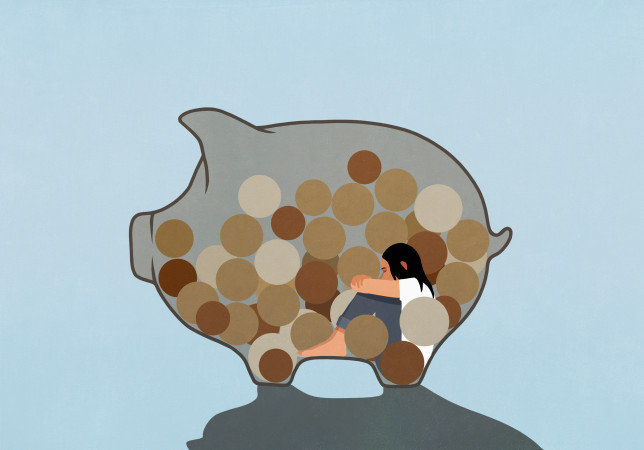 Woman inside piggy bank with coins