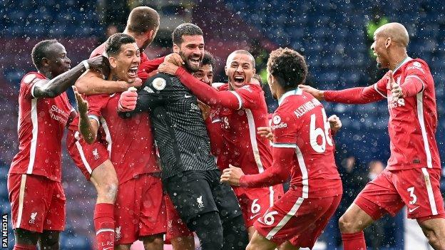 Alisson Becker celebrates scoring for Liverpool at West Brom