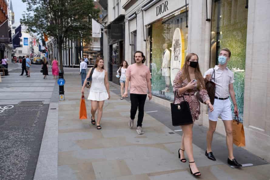 Shoppers stroll past designer stores on Bond Street